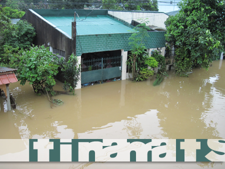 Our house in waist-deep (or so) flood, the morning after Typhoon Ondoy hit